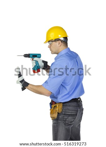 Portrait of young handsome male construction with a cordless drill isolated on white background