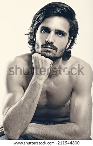 Portrait of young handsome man against white background - stock photo