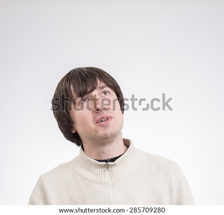 Portrait of young handsome man expressing different emotions - stock photo
