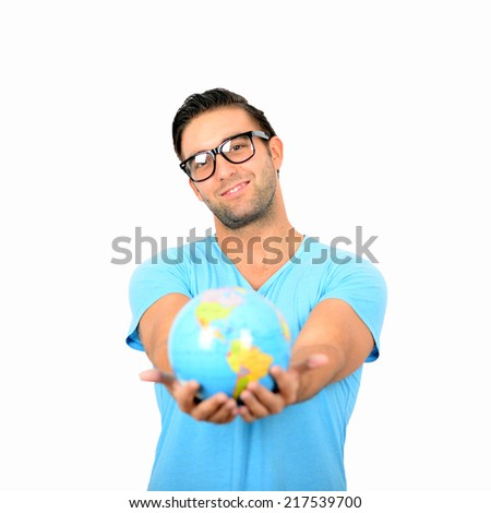 Portrait of young handsome man holding globe in hands against white background
