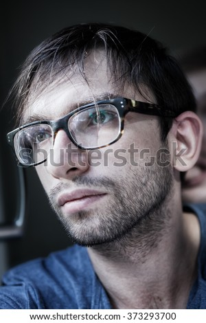 Portrait of young handsome man wearing stylish eyeglasses
