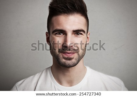 Portrait of young handsome man with stubble