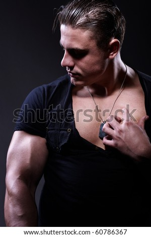 Portrait of young handsome muscular man - stock photo