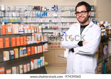 portrait of young handsome pharmacist - stock photo