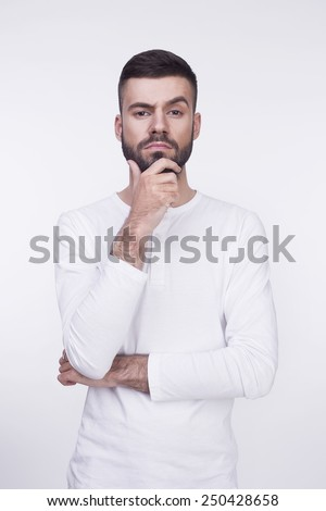 Portrait of  young handsome thoughtful man with beard. Isolated over white background - stock photo