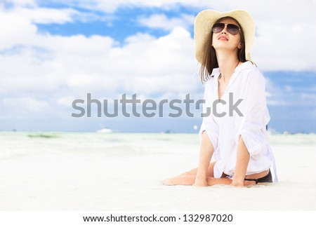 portrait of young happy beautiful on the beach - stock photo