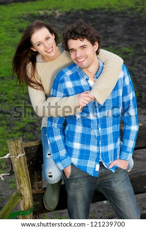 Portrait of young, happy, beautiful, smiling couple outdoors.  Handsome boyfriend and pretty girlfriend are relaxed and looking at camera - stock photo