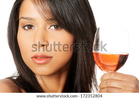 Portrait of young happy beautiful woman with glass of rose wine  - stock photo