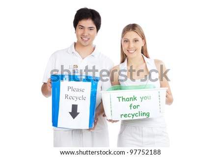 Portrait of young happy couple holding recycle bin . - stock photo