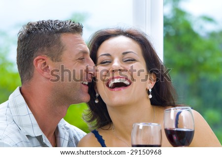 Portrait of young happy couple in domestic environment - stock photo