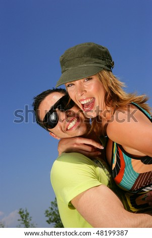 Portrait of young happy couple in summer - stock photo