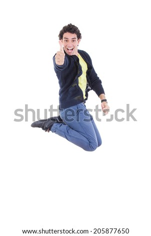 Portrait of young happy expressive caucasian man jumping of joy showing thumbs up against white background - stock photo