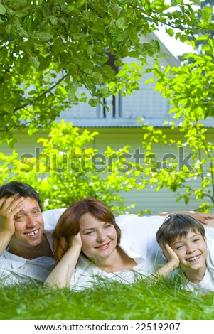 Portrait of young happy family in summer environment