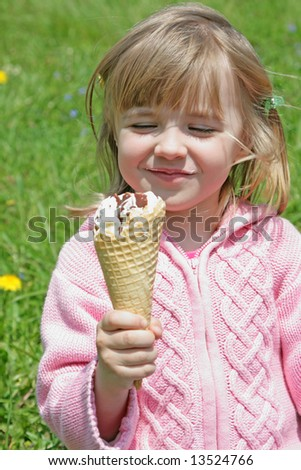 Portrait of young happy  girl  eating ice-cream