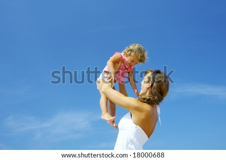 portrait of young happy mother holding her  baby - stock photo