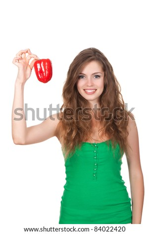 portrait of young happy smile woman hold red fresh raw pepper in hand, with long brown curly hair - isolated on white background - stock photo