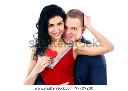 Portrait of young happy smiling attractive couple with valentine symbol, isolated on white background - stock photo