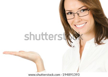 Portrait of young happy smiling businesswoman showing something or holding with copyspace, isolated over white background