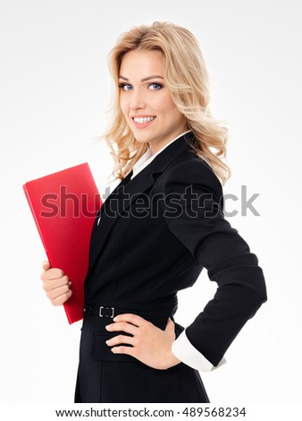 Portrait of young happy smiling businesswoman with red folder, on grey background. Caucasian blond model in business presentation concept.