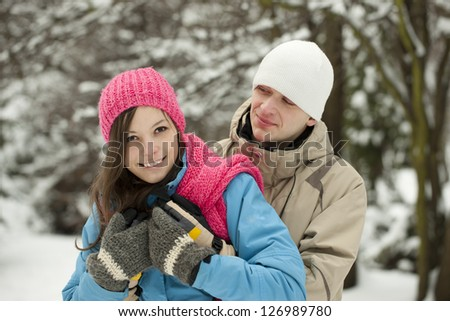 Portrait of young happy smiling couple in winter