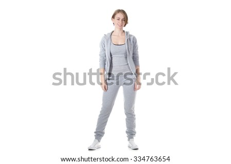 Portrait of young happy smiling slim sporty beautiful woman in sportswear, isolated studio image on white background - stock photo
