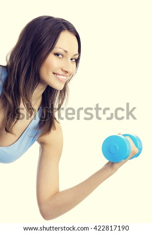 Portrait of young happy smiling woman in sportswear, doing fitness exercise with dumbbell