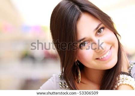 Portrait of young happy smiling woman, isolated on white - stock photo