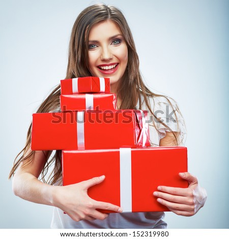 Portrait of young happy smiling woman red gift box hold. Isolated studio background female model. - stock photo