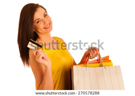 Portrait of young happy smiling woman with shopping bags, isolated over white background, warm tone - stock photo