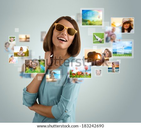 Portrait of young happy woman sharing her travel vacation photo and video files in social media
