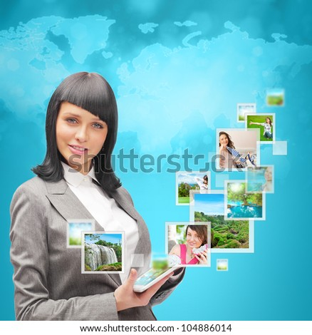 Portrait of young happy woman sharing his photo and video files in social media resources. Standing against world map - stock photo