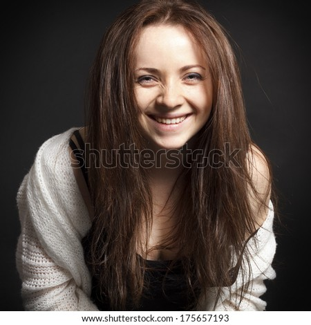 Portrait of young happy woman smiling