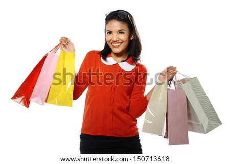 Portrait of young happy woman with shopping bags, isolated over white background