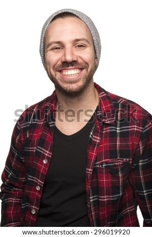 Portrait of young hipster man in studio setting - stock photo