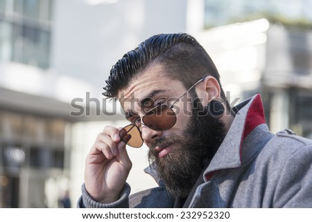 portrait of young hipsters around the capital - stock photo