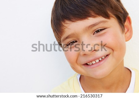 Portrait Of Young Hispanic Boy Standing By Wall