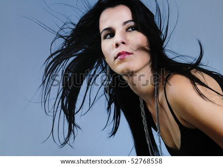 Portrait of young hispanic brunette beauty with long hair