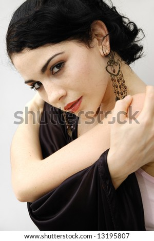 Portrait of young hispanic flamenco dancer female with seductive smile