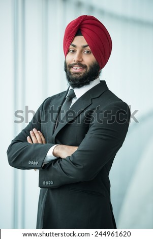 Portrait of young indian businessman in suit and turban. - stock photo