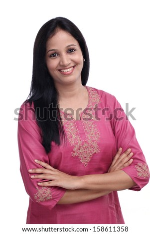 Portrait of young Indian woman against white background - stock photo