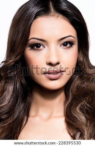Portrait of young indian woman on white background - stock photo