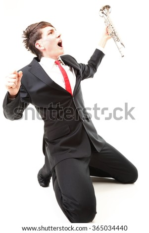Portrait of young jazz man joy, glee and his trumpet white background - stock photo