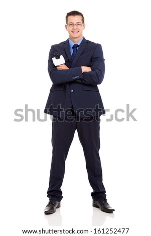 portrait of young journalist with arms crossed on white background