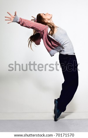 Portrait of young jumping girl with background - stock photo