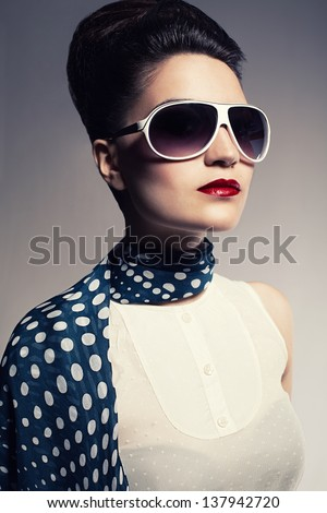 portrait of young lady wearing a scarf and a sunglasses - stock photo