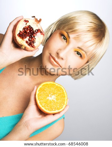 Portrait of young lady with fruits in her hands