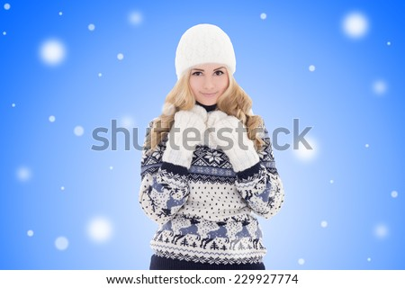 portrait of young lovely beautiful girl in winter clothes over winter background - stock photo