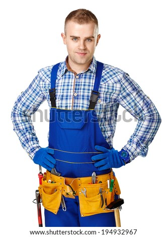 Portrait of young male construction worker with tool belt isolated on white background