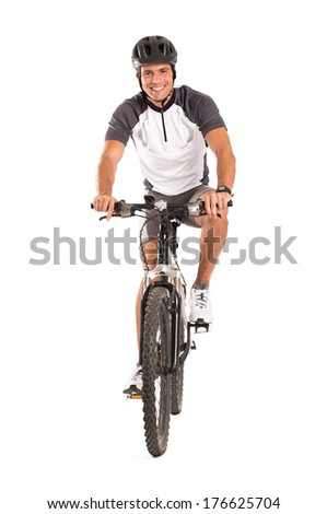 Portrait Of Young Male Cyclist On Bicycle Isolated Over White Background  - stock photo