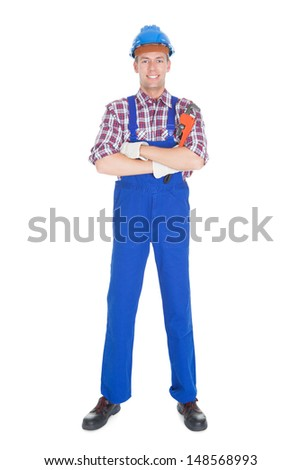 Portrait Of Young Male Worker Isolated Over White Background